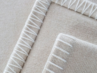Wool blanket with white whipstitch
