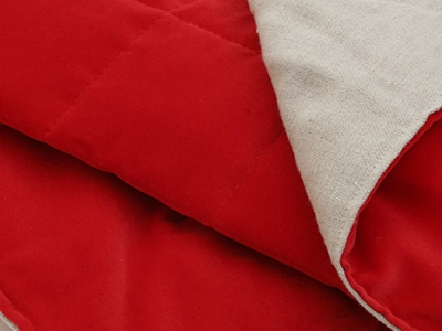 Quilted bed runner in red velvet back in linen