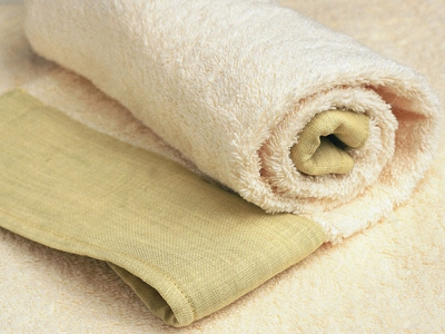 Face towel bordered with light green linen