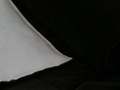 Quilted bed runner in black velvet back in linen