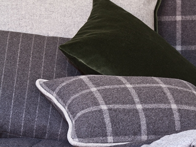 Grey and white wool and green velvet decorative cushions