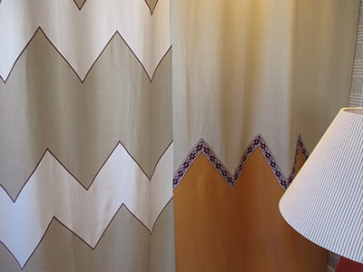Special curtain panels in linen with trims and cordonnet finishing