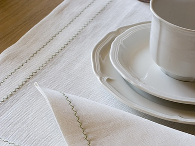 Linen table runner with zig-zag embroidery