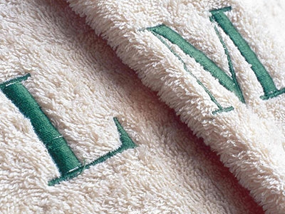 It's possible to put embroidered logo or initials on terrycloth